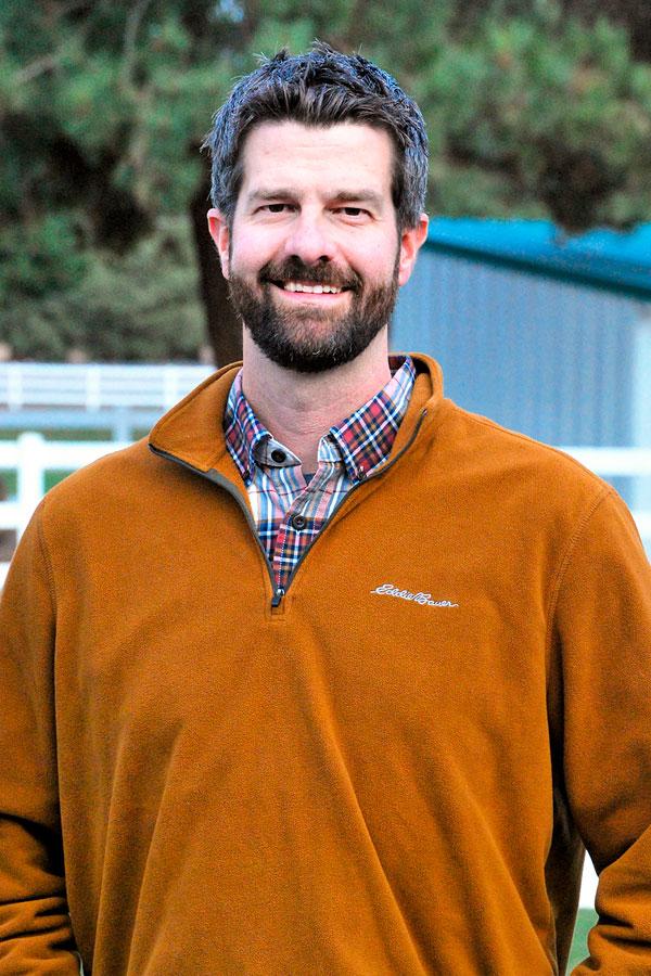 Headshot of board member Adam Nichols