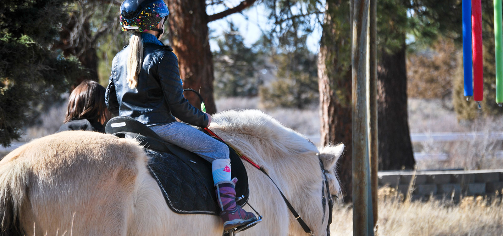 child riding therapeutic horse