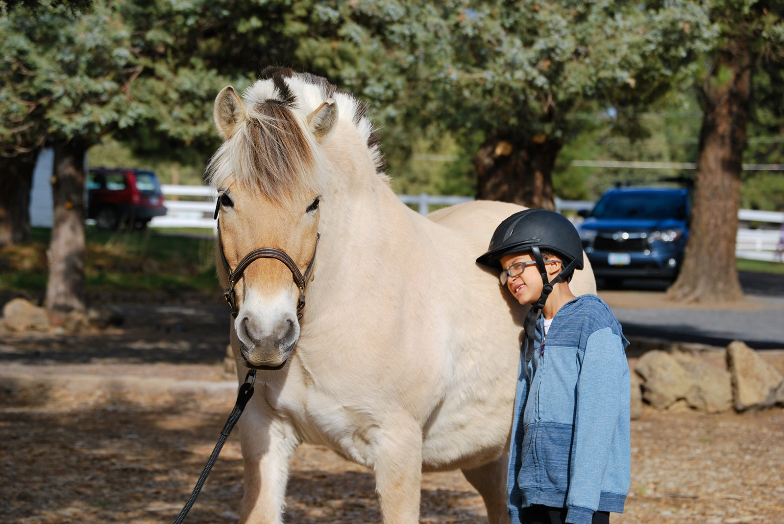 Boy with horse at Healing Reins